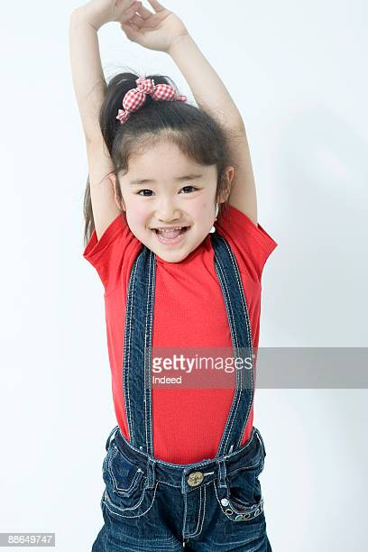 japanese girl (6-7 years) raising arms, smiling - 6 7 years stock pictures, royalty-free photos & images