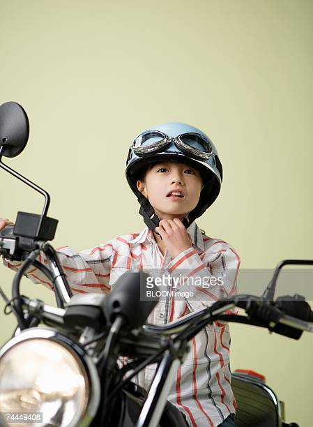 Japanese girl smiling with sitting on seat of motorbike
