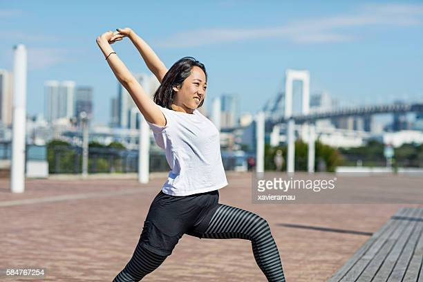 Japanese girl stretching in the morning at Tokyo