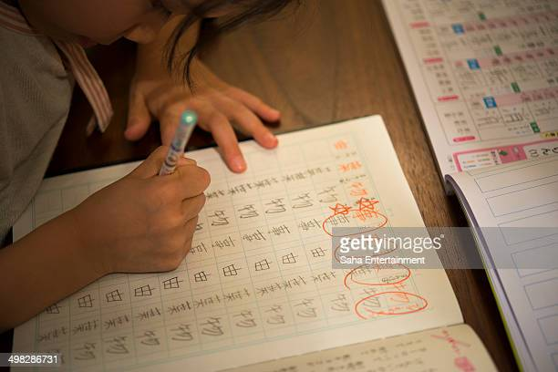 japanese girl study japanese - saha entertainment stock pictures, royalty-free photos & images