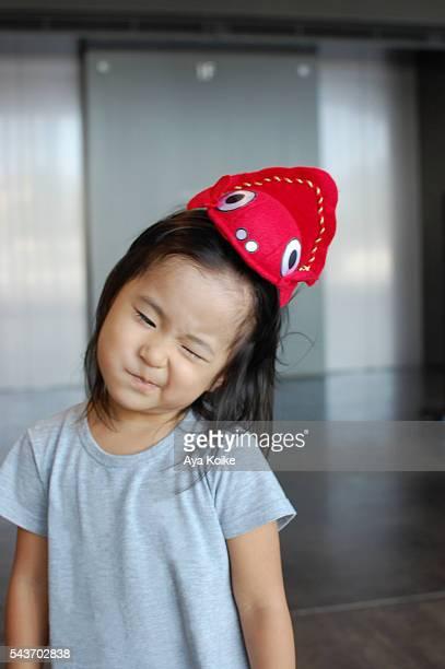 A Japanese girl wearing a red goldfish Nebuta hairband