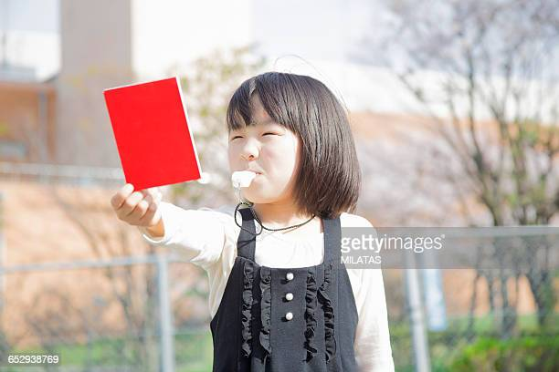 Japanese girl with a red card