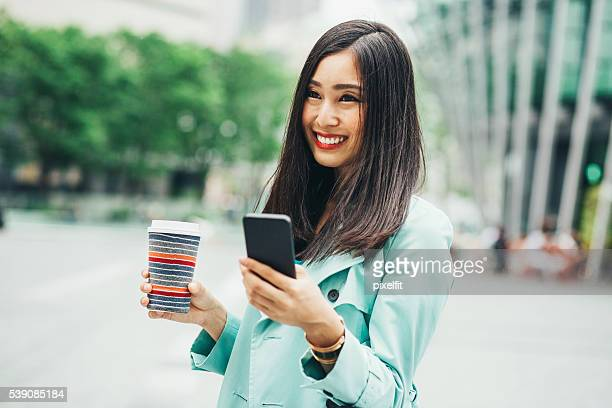 Japanese girl with phone and coffee