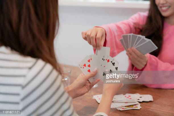 Japanese girls enjoy playing cards with each other