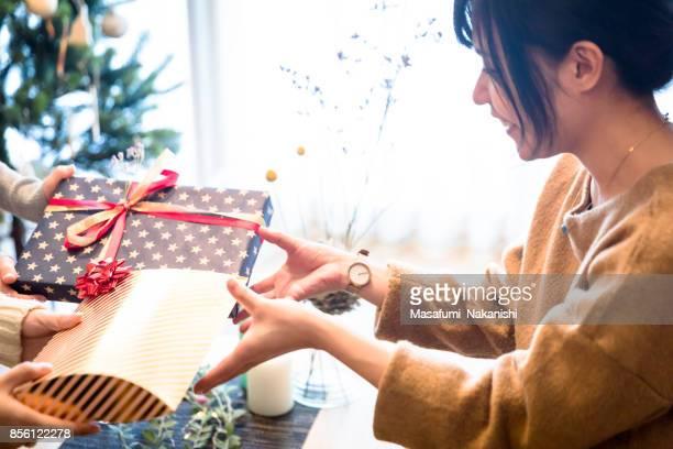 Japanese girls enjoying gifts exchange