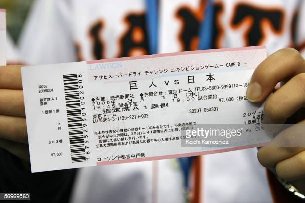 Japanese girls hold tickets for the 2006 World Baseball Classic Exhibition Game between Japan and the Yomiuri Giants at the Tokyo Dome on March 1...