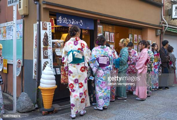 japanese girls queueing for ice cream - for stock pictures, royalty-free photos & images