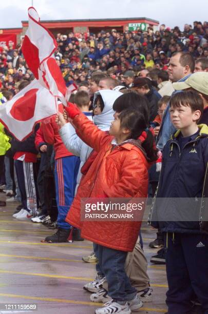 Japanese girls support their team with flags during the Rugby World Cup firstround match between Japan and Samoa 03 October 1999 at Racecourse Ground...