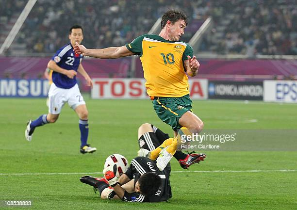 Japanese goalkeeper Eiji Kawashima saves an attempt on goal from Harry Kewell of Australia during the AFC Asian Cup Final match between the...
