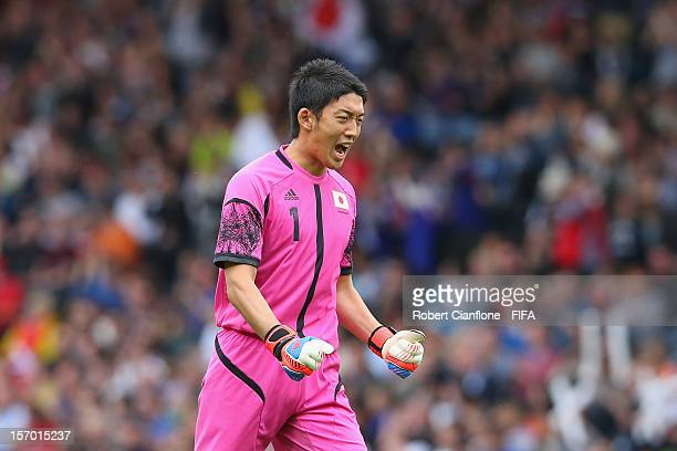 Japanese goalkeeper Shuichi Gonda celebrates after teammate Yuki Otsu scored during the Men's Football first round Group D Match of the London 2012...