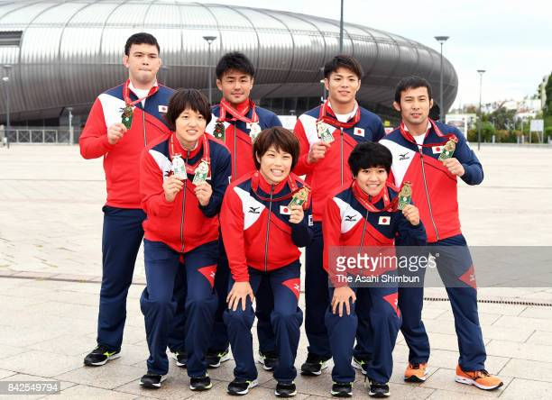 Japanese gold medalists Chizuru Arai Ai Shishime and Funa Tonaki Aaron Wolf Soichi Hashimoto Hifumi Abe and Naohisa Takato pose for photographs a day...