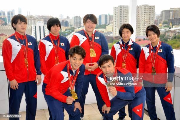 Japanese gold medalists Hifumi Abe and Naohisa Takato Chizuru Arai Shori Hamada Sarah Asahina Tsukasa Yoshida and Uta Abe pose for photographs during...