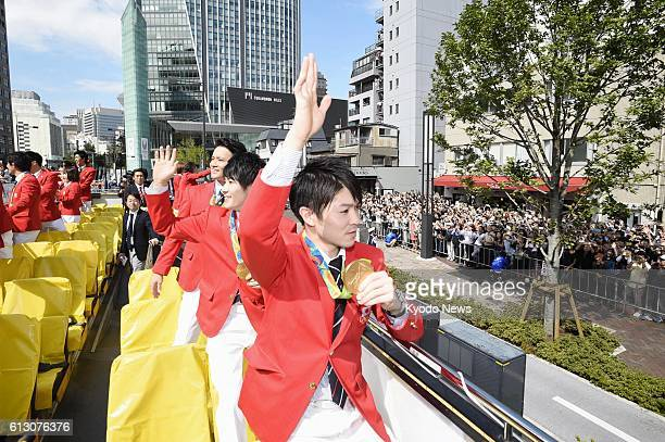 Japanese goldwinning gymnast Kohei Uchimura and other athletes wave to spectators during a parade of Rio de Janeiro Olympics and Paralympics...