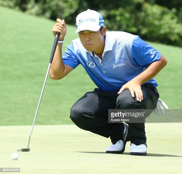 Japanese golfer Hideki Matsuyama lines up a putt during the PGA Championship in August 2017 in Charlotte North Carolina Matsuyama is scheduled to...