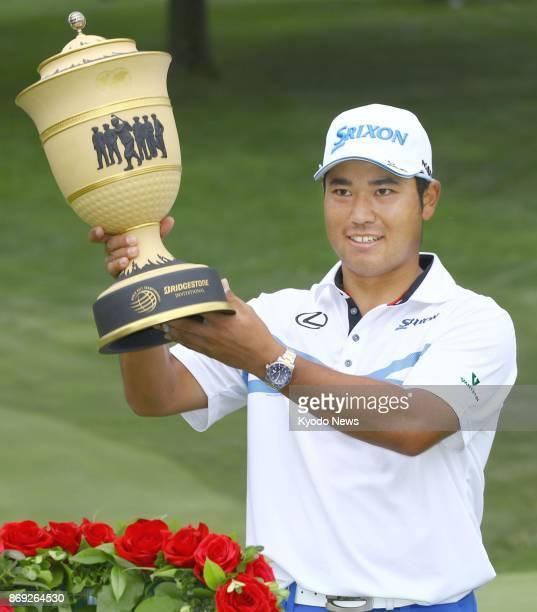 Japanese golfer Hideki Matsuyama poses with his trophy after winning the WGCBridgestone Invitational in Akron Ohio in August 2017 Matsuyama is...