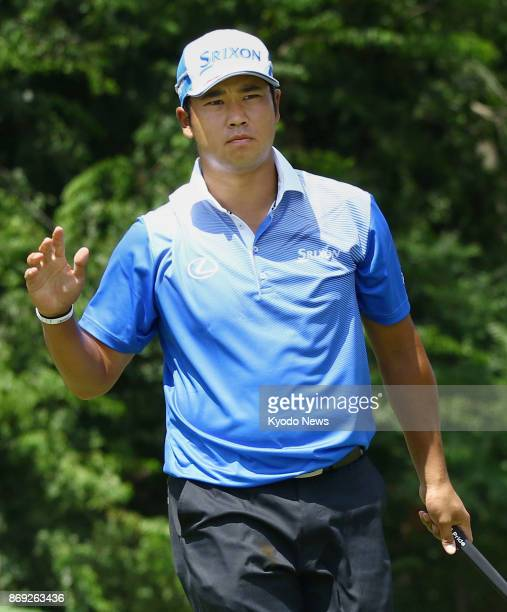 Japanese golfer Hideki Matsuyama reacts to cheers from spectators in August 2017 after carding a birdie on the eighth hole in the first round of the...