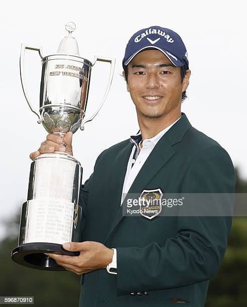 Japanese golfer Ryo Ishikawa holds the winner's trophy after capturing his first win of the season at the JGTO tour's Rizap KBC Augusta at Keya Golf...
