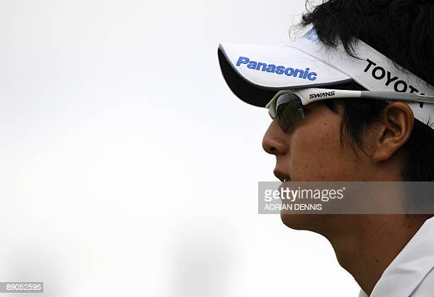 Japanese golfer Ryo Ishikawa walks down the 1st fairway on the first day of the 138th British Open Championship at Turnberry Golf Course in south...