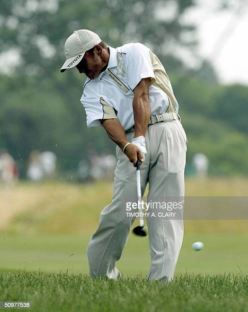 Japanese golfer Shigeki Maruyama hits out of the rough on the third hole during the third round of play at the 2004 US Open Championship at...