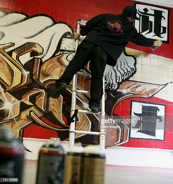 Japanese graffiti artist Kress near completions of artwork on the wall of StolenSpace gallery prior to tonight's exhibition opening and launch of the...