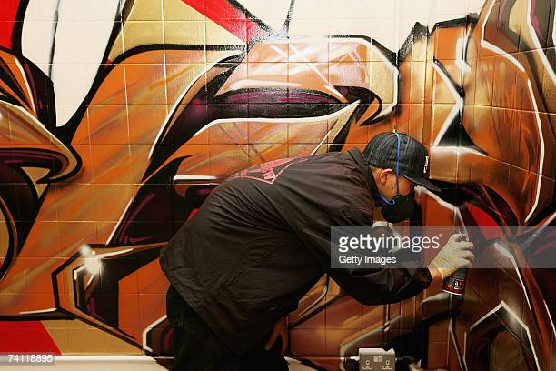 Japanese graffiti artist Kress nears completion of artwork on the wall of StolenSpace gallery prior to tonight's exhibition opening and launch of the...