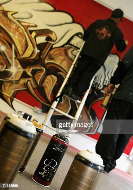Japanese graffiti artists Kress and Esow near completion of their artwork on the wall of StolenSpace gallery prior to tonight's exhibition opening...