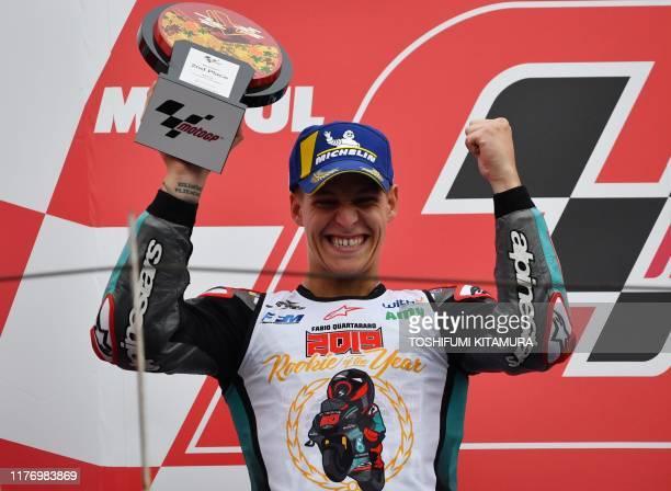Japanese Grand Prix second placed Petronas Yamaha SRT rider Fabio Quartararo of France holds his trophy on the podium after the MotoGP class Japanese...