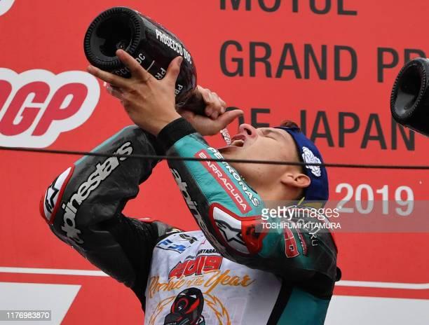 Japanese Grand Prix second placed Petronas Yamaha SRT rider Fabio Quartararo of France drinks champagne on the podium after the MotoGP class Japanese...