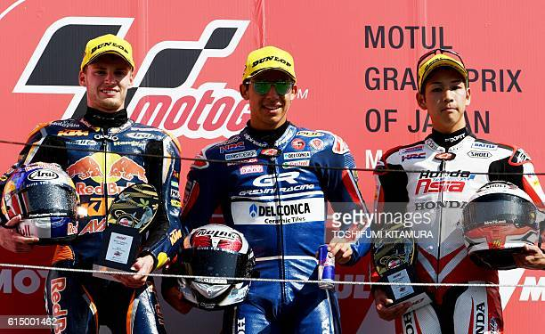 Japanese Grand Prix winner Gresini Racing Moto3's Italian rider Enea Bastianini poses with second placed Red Bull KTM Ajo's South African rider Brad...