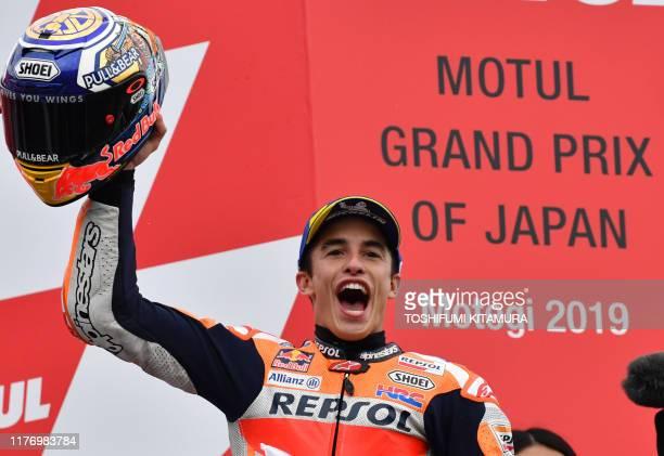 Japanese Grand Prix winner Repsol Honda Team rider Marc Marquez of Spain celebrates on the podium after the MotoGP class Japanese Motorcyle Grand...