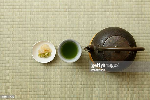 Japanese green tea with kettle on tatami, close-up