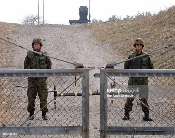 Japanese Ground SelfDefense Force members stand guard the Patriot Advanced Capability3 interceptors on April 4 2009 in Akita Japan North Korea has...