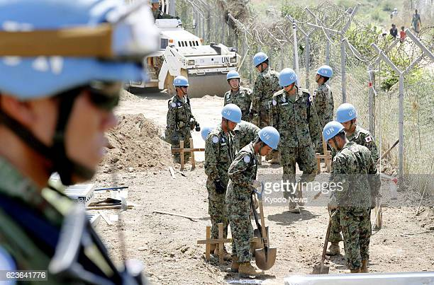 Japanese ground SelfDefense Force personnel set up safety shields at a facility for peacekeeping operations in Juba South Sudan on Nov 14 2016 The...