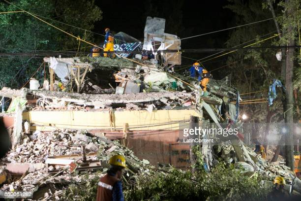 Japanese group of rescuers work in a destroyed multifamiliar building three days after the magnitude 71 earthquake jolted central Mexico killing more...
