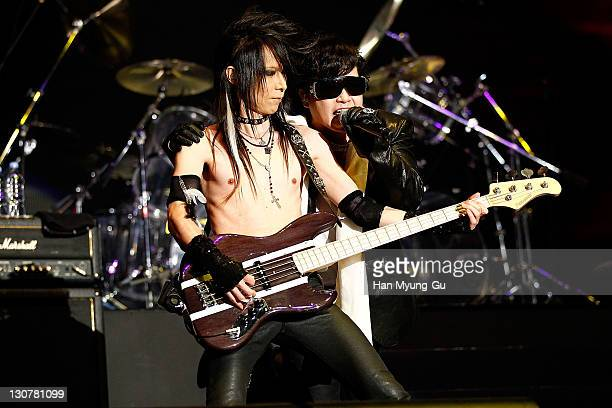 Japanese guitarist Heath and singer Toshi of the band X Japan performs live during a concert at Olympic Gymnasium on October 28 2011 in Seoul South...