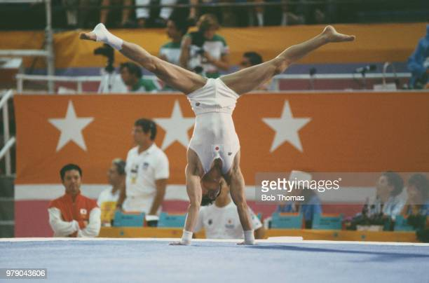 Japanese gymnast Noritoshi Hirata pictured in action on the floor exercise during competition in the Men's individual allaround gymnastics event at...