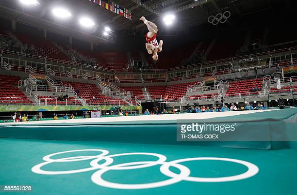 A Japanese gymnast practices his floor routine at the Olympic Arena the venue of the men's Artistic gymnastics on August 3 2016 ahead of the Rio 2016...