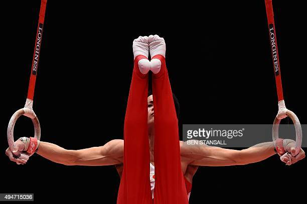 Japanese gymnast Yusuke Tanaka competes on the rings during the Men's Team event final on the sixth day of the 2015 World Gymnastics Championship in...