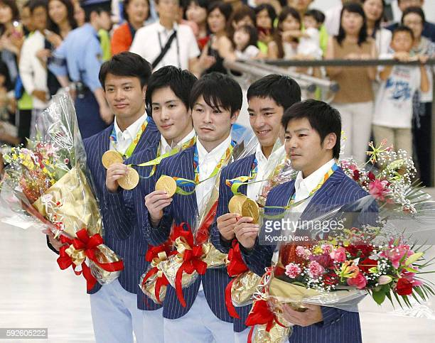Japanese gymnasts Yusuke Tanaka Ryohei Kato Kohei Uchimura Kenzo Shirai and Koji Yamamuro who won gold in the men's team event at the Rio Olympics...