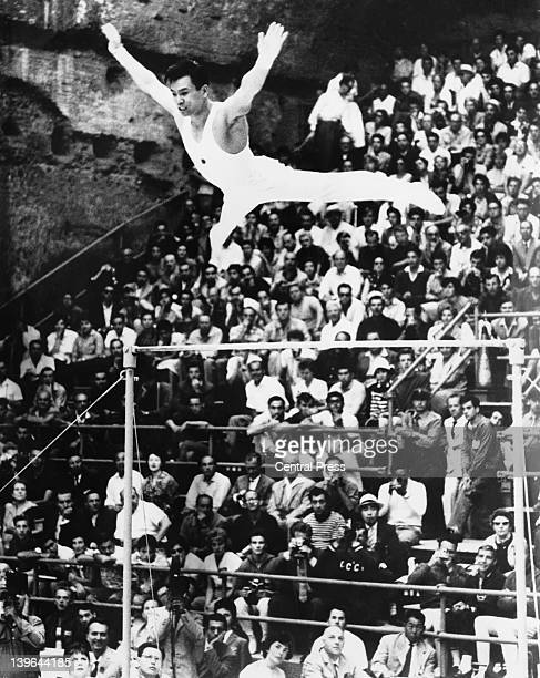 Japanese gymnnast Takashi Ono competing on the uneven bars in the men's individual allaround gymnnastics event at the Baths of Caracalla during the...