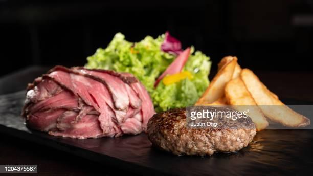 japanese hamburger steak with rice wrapped in beef, salad, fries - yōshoku imagens e fotografias de stock