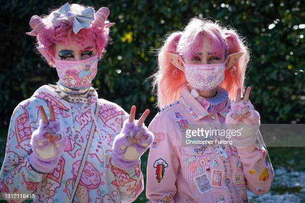 Japanese Harajuku style fans wear face masks as they wait to ride the rollercoasters at Alton Towers on the first day opening after after lockdown...
