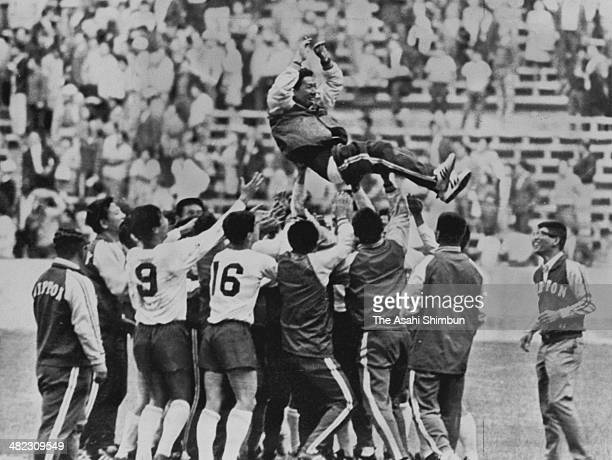 Japanese head coach Ken Nagamuna is thrown into the air after Japan winning bronze medal during the Mexico Olympic Football Bronze Medal Match...