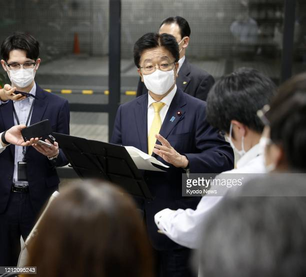 Japanese health minister Katsunobu Kato meets the press in Tokyo on May 7 after the government approved the use of the anti-viral drug Remdesivir for...