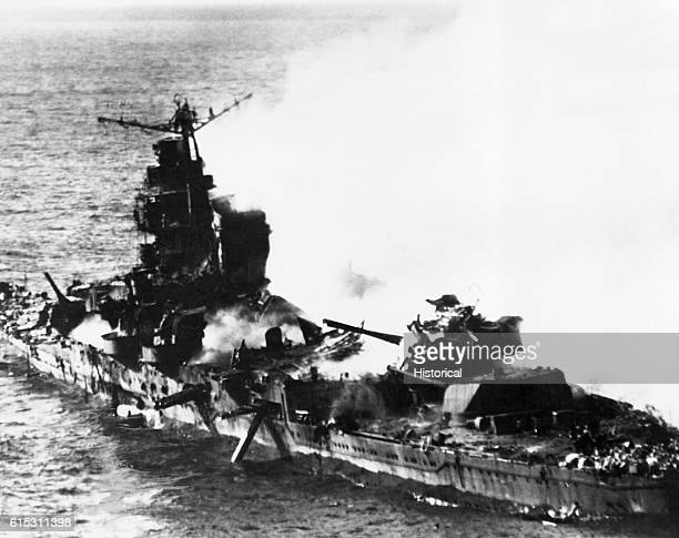 A Japanese heavy cruiser of the Mogame class on fire after attack by planes of Task Force16 during the Battle of Midway Near Midway 1942 | Location...