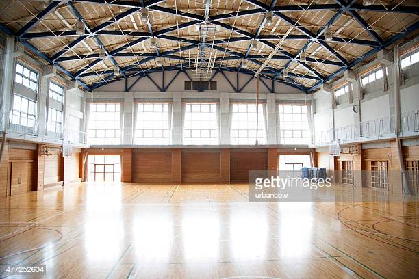 Japanese high school. An empty school gymnasium. Basketball court markings