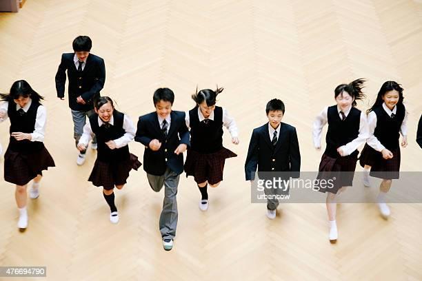 Japanese high school children, eight teenage children run, school hall