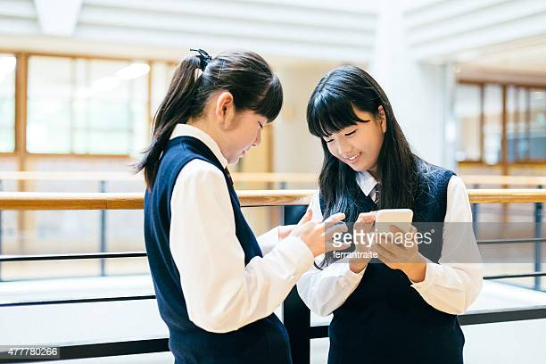 Japanese High School Girl Students using Smartphones at school