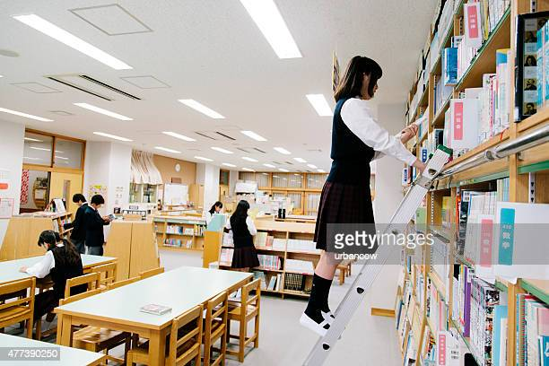 Japanese high school, library. Choosing a book, ladder