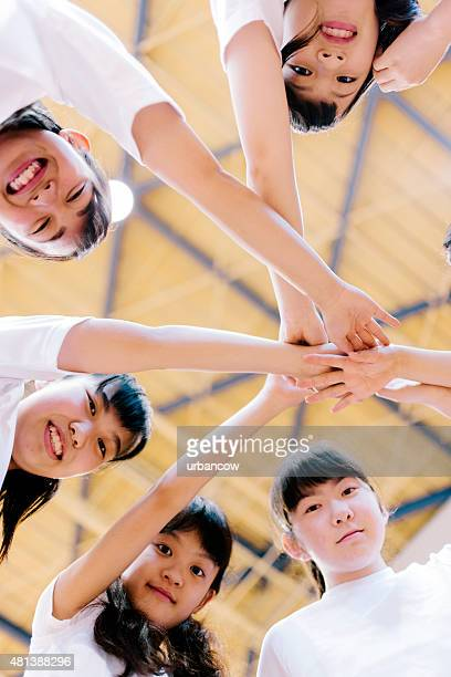 Japanese high school. School gymnasium. Basketball team, circle of hands
